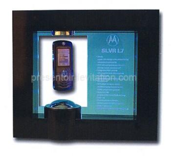 objet publicitaire - présentoir à lévitation rectangulaire avec cartel publicitaire présentant un téléphone mobile