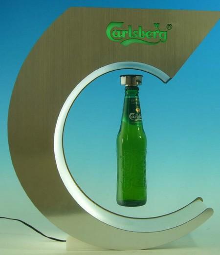 présentoir de comptoir - présentoir à lévitation présentant une bouteille éclairée par le pourtour