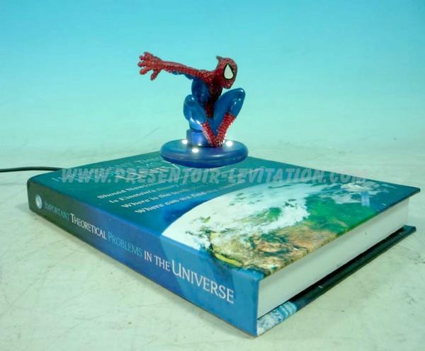 présentoir sur pied - présentoir à lévitation dont la base à la forme d'un livre fait flotter une figurine