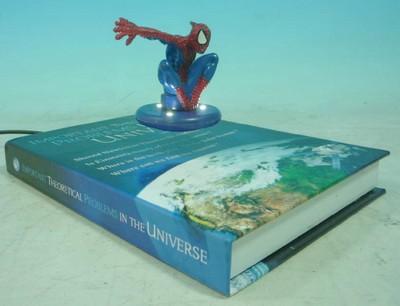 présentoir de comptoir - base magnétique en forme de livre faisant flotter une figurine éclairée par des leds