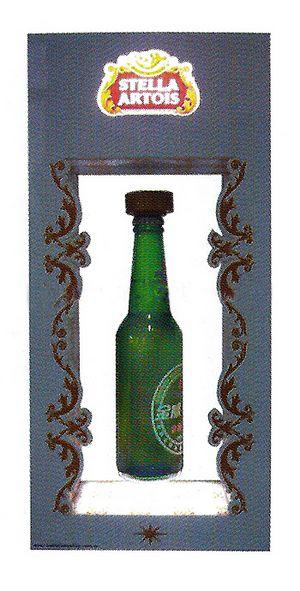 plv marketing - présentoir à lévitation pour bouteille avec logo lumineux sur le fronton du cadre