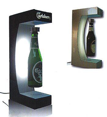 marketing - présentoir à lévitation pour bouteille avec logo éclairé sur le fronton du support